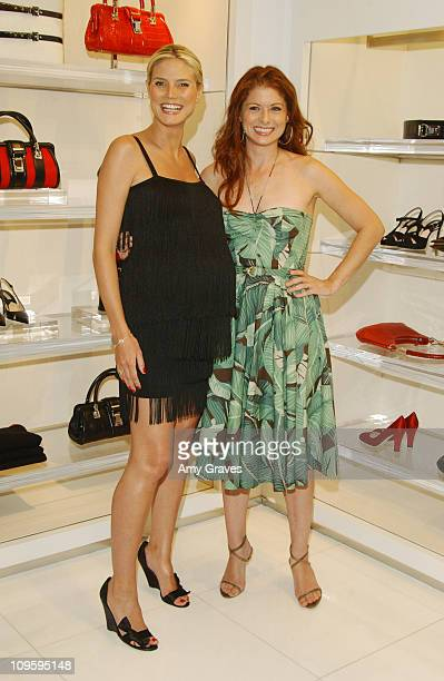 Heidi Klum and Debra Messing during Heidi Klum and Michael Kors Host 'Project Runway' Party August 25 2005 at Michael Kors Boutique in Beverly Hills...
