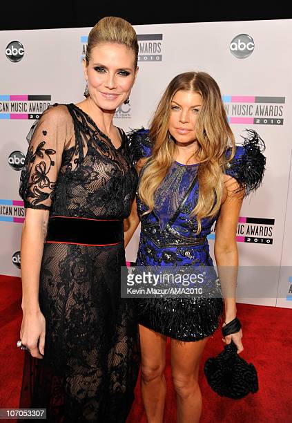 Heidi Klum and Fergie arrive at the 2010 American Music Awards held at Nokia Theatre L.A. Live on November 21, 2010 in Los Angeles, California.