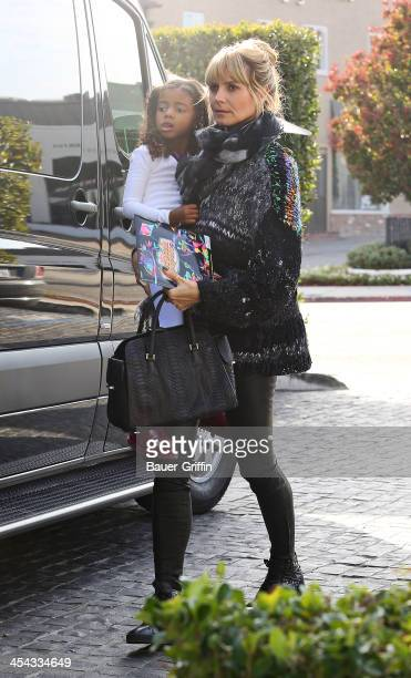 Heidi Klum and her daughter Lou Samuel are seen on December 08 2013 in Los Angeles California