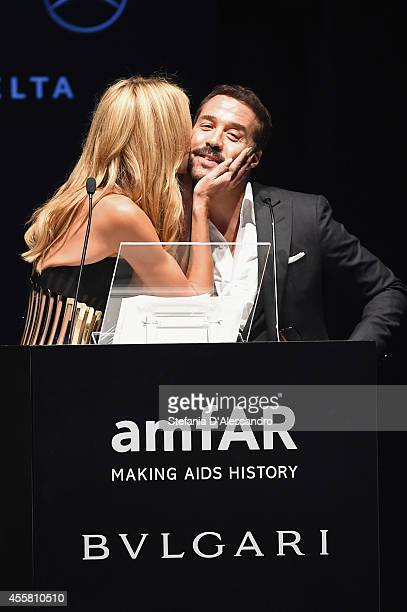 Heidi Klum and Jeremy Piven seen on stage during the amfAR Milano 2014 Gala Dinner and Auction as part of Milan Fashion Week Womenswear Spring/Summer...