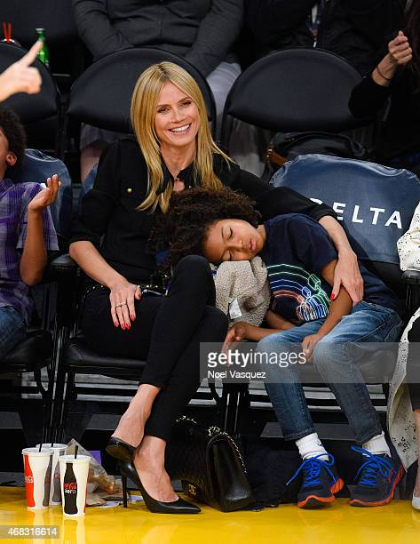 Heidi Klum and Johan Samuel attend a basketball game between the New Orleans Pelicans and the Los Angeles Lakers at Staples Center on April 1, 2015...