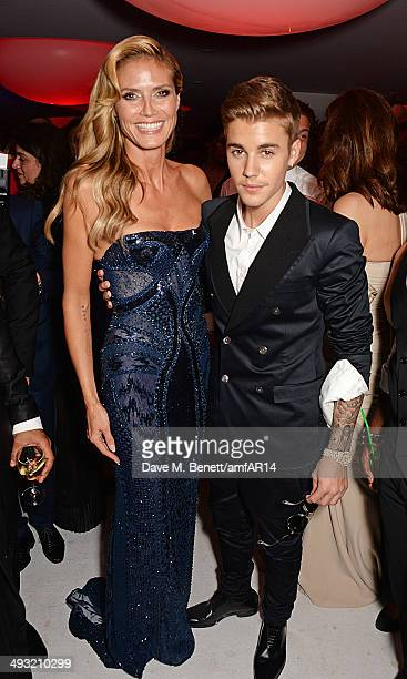 Heidi Klum and Justin Bieber attend amfAR's 21st Cinema Against AIDS Gala after party presented by WORLDVIEW BOLD FILMS and BVLGARI at Hotel du...