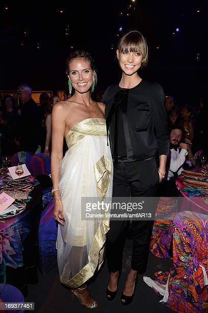 Heidi Klum and Karlie Kloss attends amfAR's 20th Annual Cinema Against AIDS during The 66th Annual Cannes Film Festival at Hotel du CapEdenRoc on May...