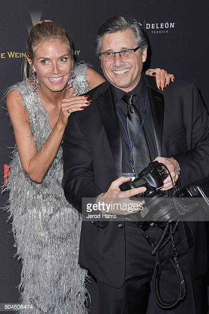 Heidi Klum and Kevin Mazur arrive at the 2016 Weinstein Company and Netflix Golden Globes After Party on January 10 2016 in Los Angeles California