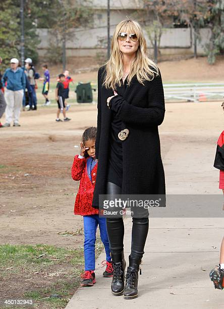 November 16: Heidi Klum and Lou Samuel are seen on November 16, 2013 in Los Angeles, California.