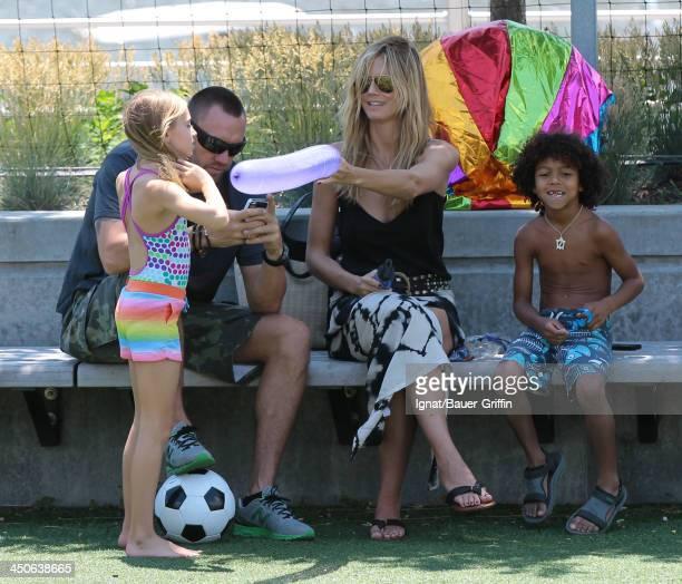 June 21: Heidi Klum and Martin Kristen with her children Leni Samuel and Johan Samuel are seen on June 21, 2013 in New York City.
