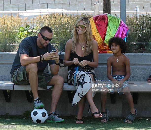 June 21: Heidi Klum and Martin Kristen with Johan Samuel are seen on June 21, 2013 in New York City.