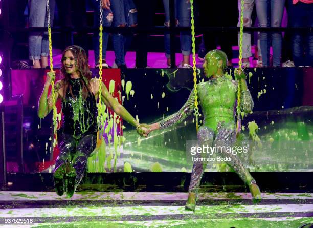 Heidi Klum and Mel B get slimed onstage at Nickelodeon's 2018 Kids' Choice Awards at The Forum on March 24 2018 in Inglewood California