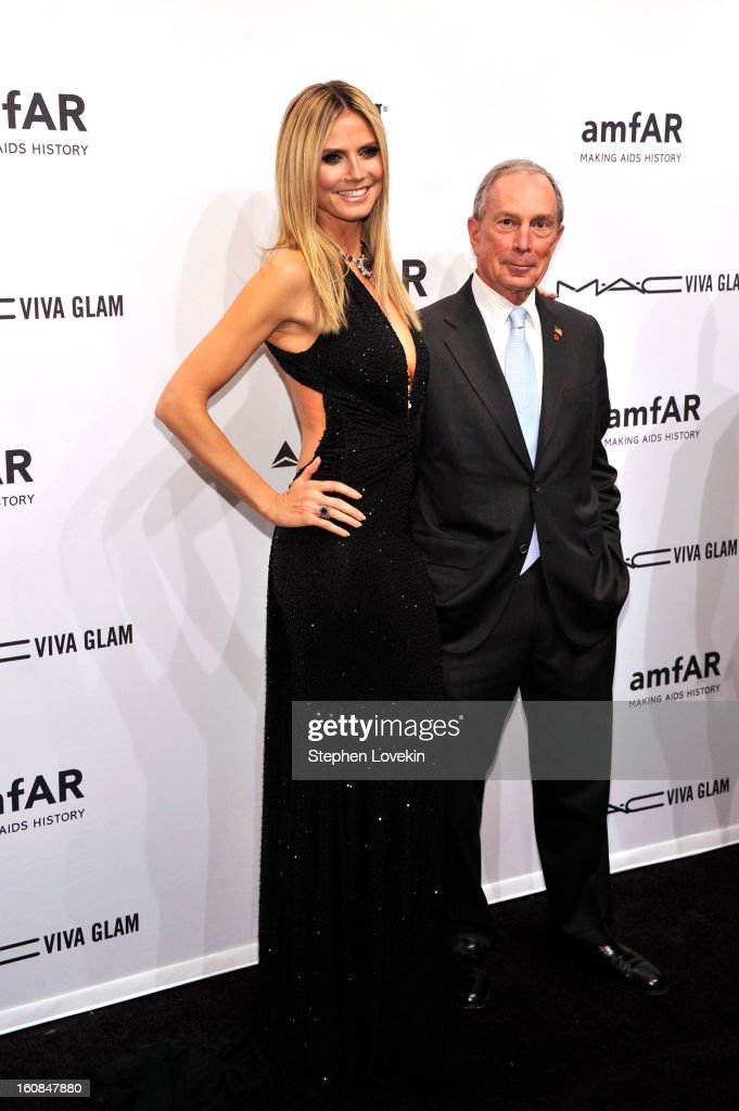 Heidi Klum (L) and Michael Bloomberg attend the amfAR New York Gala to kick off Fall 2013 Fashion Week at Cipriani Wall Street on February 6, 2013 in New York City.
