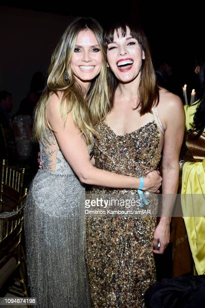 Heidi Klum and Milla Jovovich attend the amfAR New York Gala 2019 at Cipriani Wall Street on February 6 2019 in New York City