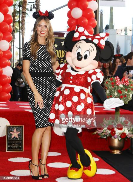 Heidi Klum and Minnie Mouse attend the ceremony honoring Disney's Minnie Mouse 90th Anniversary with a Star on The Hollywood Walk of Fame held on...