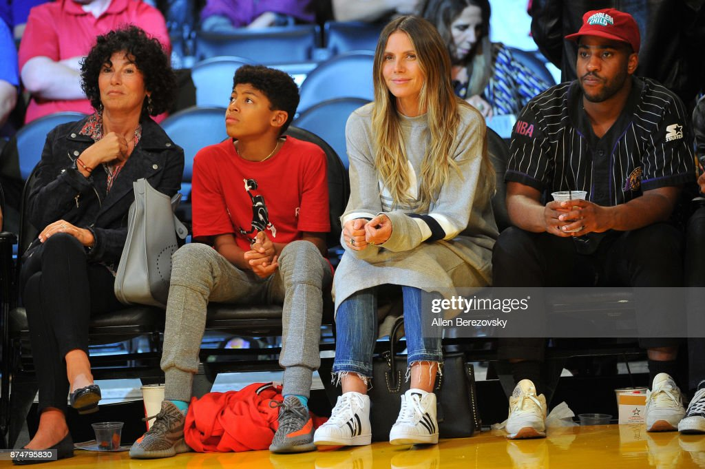 Heidi Klum and son Henry attend a basketball game between the Los Angeles Lakers and the Philadelphia 76ers at Staples Center on November 15, 2017 in Los Angeles, California.