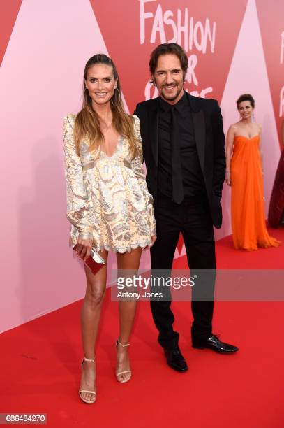 Heidi Klum and Thomas Hayo attend the Fashion for Relief event during the 70th annual Cannes Film Festival at Aeroport Cannes Mandelieu on May 21...