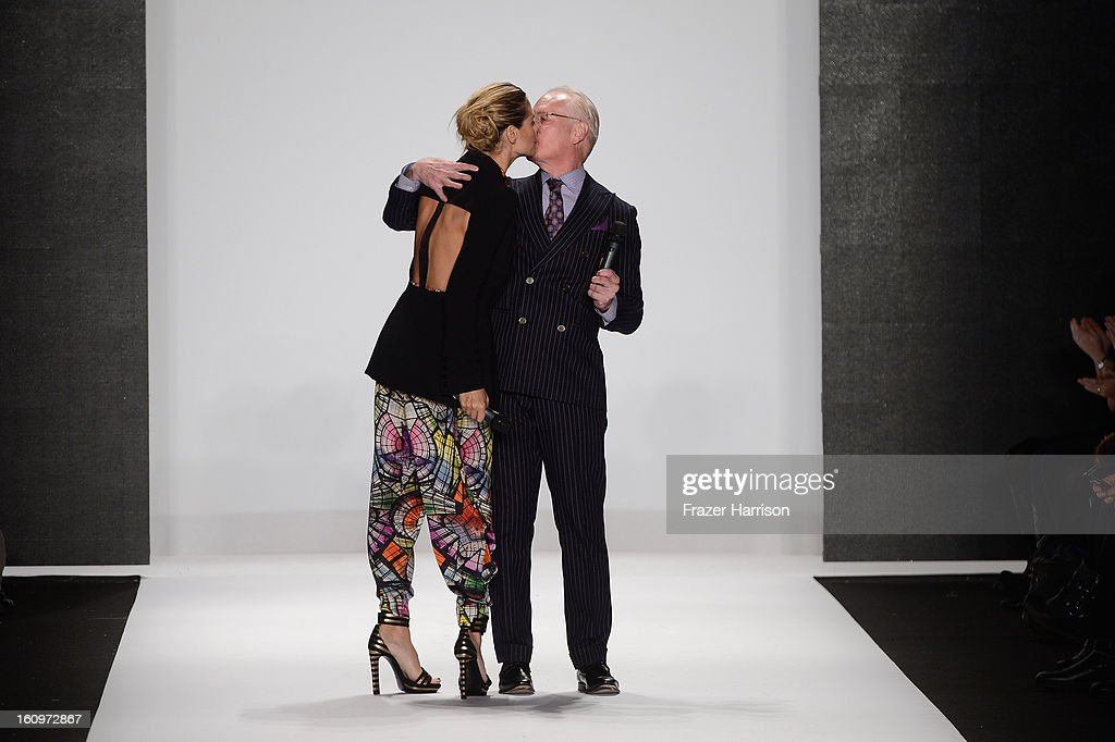 Heidi Klum and Tim Gunn speak on the runway at the Project Runway Fall 2013 fashion show during Mercedes-Benz Fashion Week at The Theatre at Lincoln Center on February 8, 2013 in New York City.