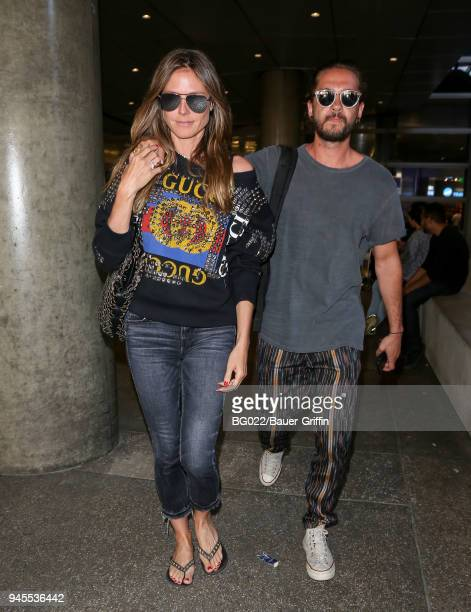 Heidi Klum and Tom Kaulitz are seen at LAX on April 12, 2018 in Los Angeles, California.