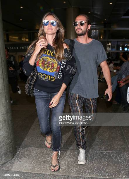 Heidi Klum and Tom Kaulitz are seen at LAX on April 12 2018 in Los Angeles California