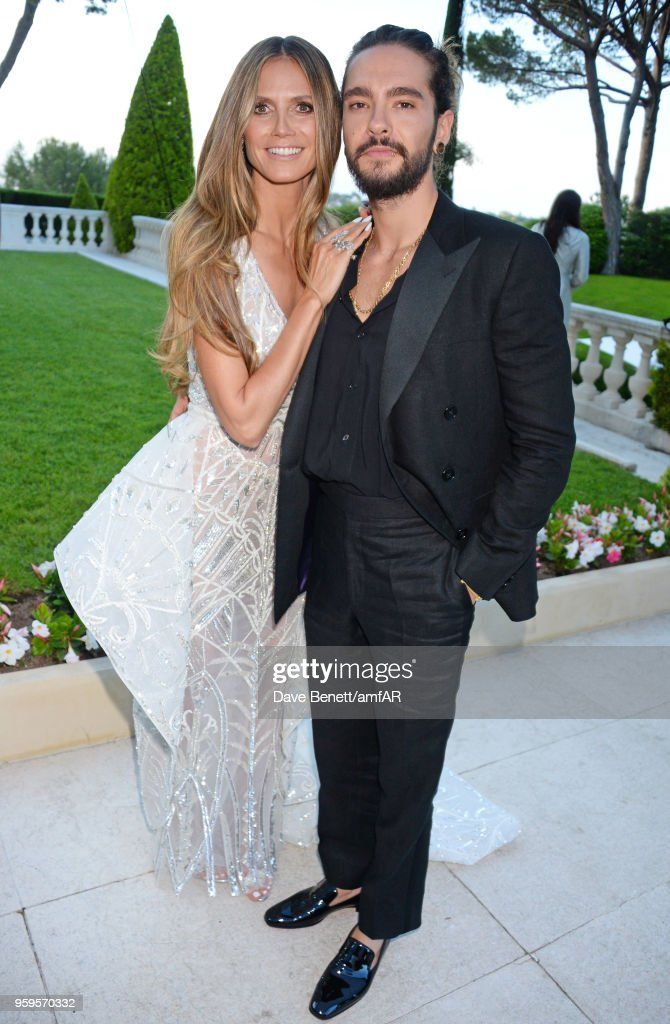 Heidi Klum (L) and Tom Kaulitz arrive at the amfAR Gala Cannes 2018 at Hotel du Cap-Eden-Roc on May 17, 2018 in Cap d'Antibes, France.