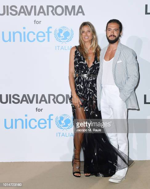 Heidi Klum and Tom Kaulitz attend a photocall for the Unicef Summer Gala Presented by Luisaviaroma at Villa Violina on August 10 2018 in Porto Cervo...