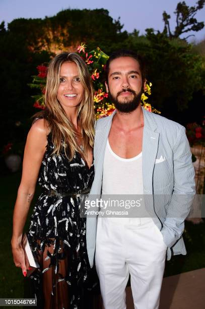 Heidi Klum and Tom Kaulitz attend the Unicef Summer Gala Presented by Luisaviaroma cocktail party at Villa Violina on August 10 2018 in Porto Cervo...