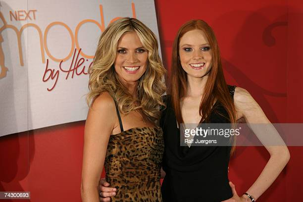 Heidi Klum and winner Barbara attend a photocall for PRO7 TV show Germanys Next Topmodel on May 24 2007 at Cologne Germany