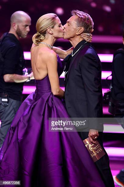 Heidi Klum and Wolfgang Joop kiss on stage during the Bambi Awards 2015 show at Stage Theater on November 12 2015 in Berlin Germany