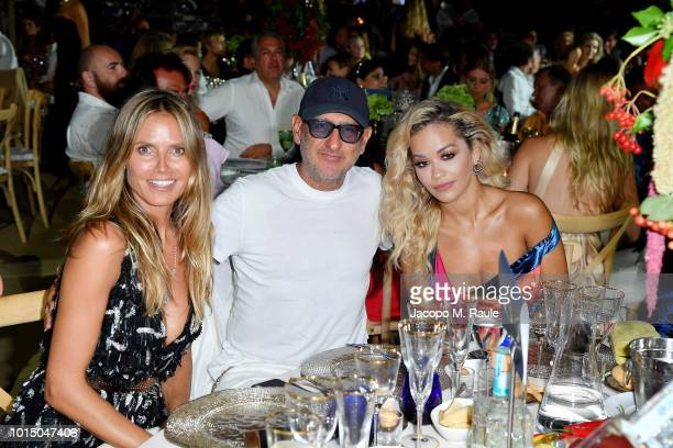 Heidi Klum Andrea Panconesi and Rita Ora attend the Unicef Summer Gala Presented by Luisaviaroma afterparty at Villa Violina on August 10 2018 in...