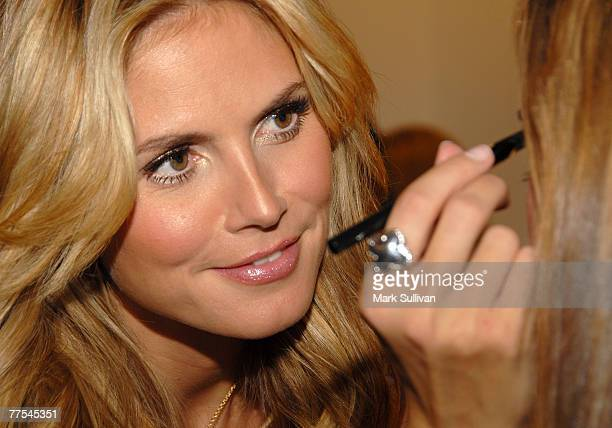 Heidi Klum applies makeup to drawing winner at the Heidi Klum Very Sexy Makeup Collection launch held at The Grove on October 26 2007 in Los Angeles...