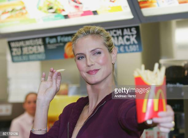 Heidi Klum attends a photocall to kick off her cooperation with McDonalds at a restaurant in Hamburg on February 9 2004 in Hamburg Germany