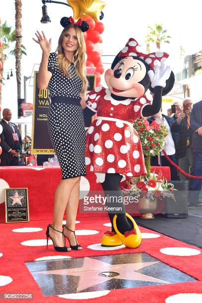 Heidi Klum attends ceremony for Minnie Mouse as she receives Star on Hollywood Walk of Fame in Celebration of her 90th Anniversary at El Capitan...