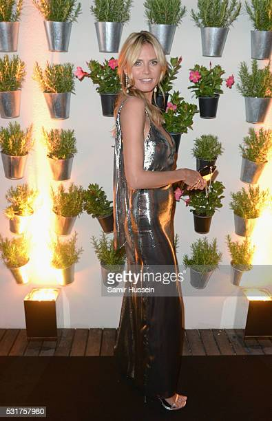 Heidi Klum attends The Harmonist Cocktail Party during the 69th annual Cannes Film Festival at the Plage du Grand Hyatt on May 16 2016 in Cannes...