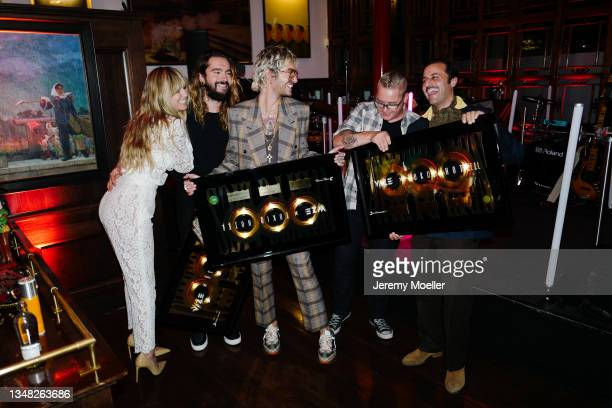 Heidi Klum, Bill Kaulitz, Tom Kaulitz, Gustav Schäfer and Georg Listing seen backstage during the Tokio Hotel New Album Release Party on October 22,...
