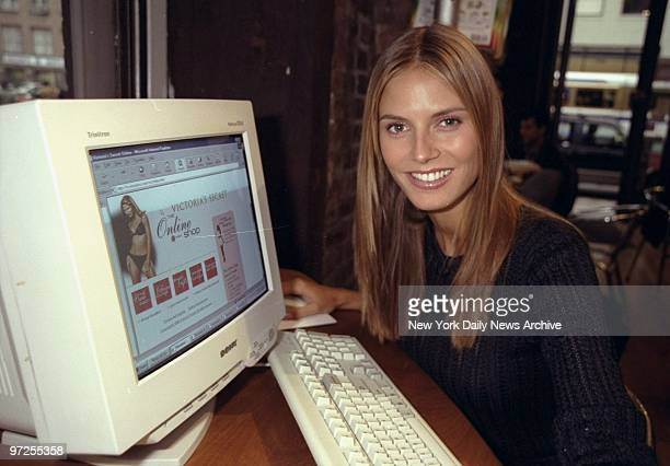 Heidi Klum checking out the Victoria's Secret web site at the Cyber Space cafe