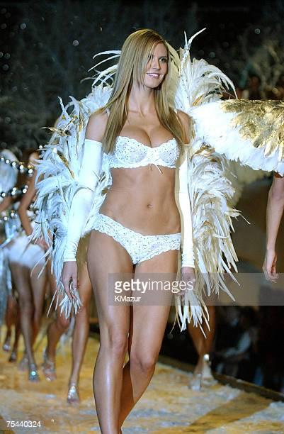 Heidi Klum during finale wearing white Victoria's Secret heavenly lace unlined demi and bikini