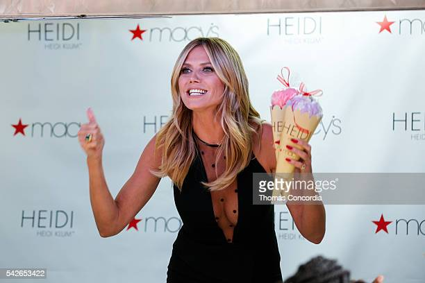 Heidi Klum gives away samples inside the ice cream truck during the Heidi Klum Lingerie Party at Macy's Herald Square on June 23 2016 in New York City