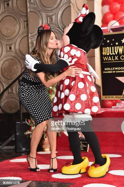 Heidi Klum gives Minnie Mouse a kiss during a star ceremony in celebration of the 90th anniversary Disney's Minnie Mouse at the Hollywood Walk of...