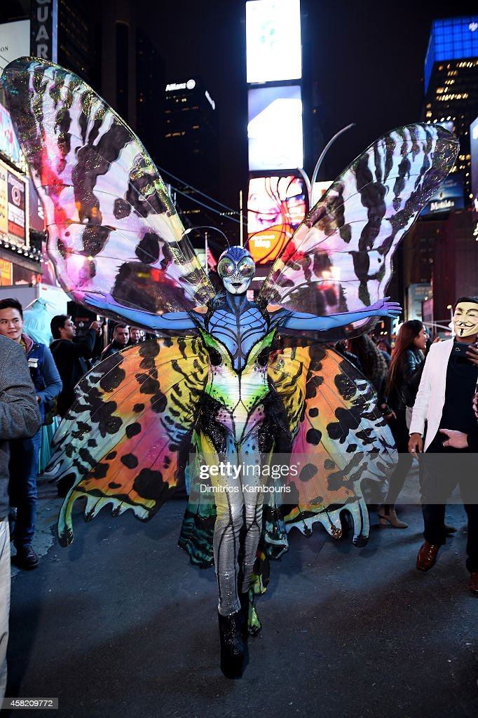 Heidi Klum gives Times Square visitors a sneak peek of her Halloween costume before hosting her annual party at TAO Downtown sponsored Bby Moto X on October 31, 2014 in New York City.