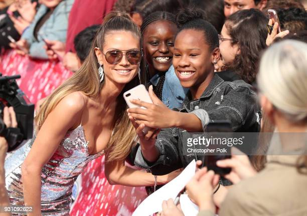 Heidi Klum greets fans and takes selfies at the red carpet kickoff for 'America's Got Talent' season 13 at Pasadena Civic Auditorium on March 12 2018...