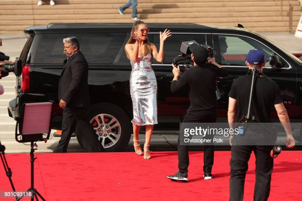Heidi Klum greets fans at the red carpet kickoff for America's Got Talent season 13 at Pasadena Civic Auditorium on March 12 2018 in Pasadena...