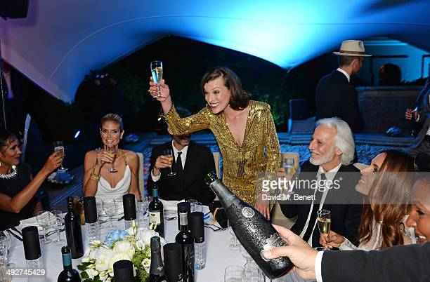Heidi Klum guest Milla Jovovich Hermann Buehlbecker and guest attend the welcome party for Puerto Azul Experience Night at Villa St George on May 21...