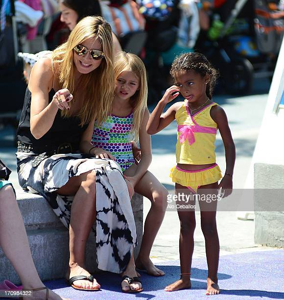 Heidi Klum, Helene Boshoven Samuel and Lou Sulola Samuel are seen in Tribeca Hudson River Park on June 20, 2013 in New York City.