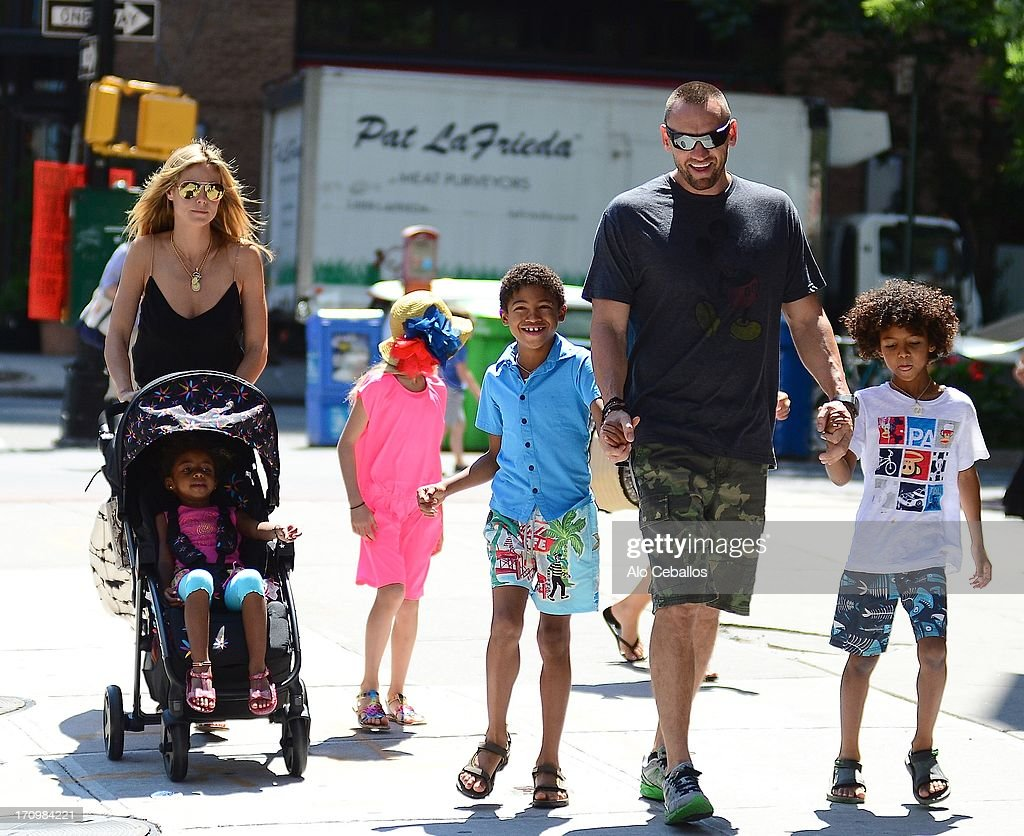 Heidi Klum, Helene Boshoven Samuel, Lou Sulola Samuel, Johan Riley Fyodor Taiwo Samuel, Henry Gunther Ademola Dashtu Samuel and Martin Kristen are seen in Tribeca Hudson River Park on June 20, 2013 in New York City.