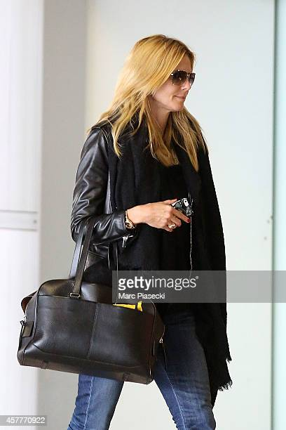 Heidi Klum is seen at CharlesdeGaulle airport on October 24 2014 in Paris France