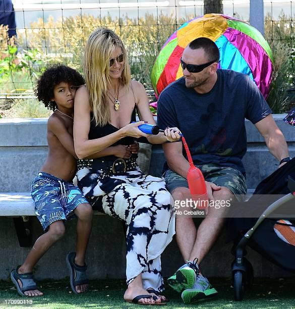 Heidi Klum, Johan Riley Fyodor Taiwo Samuel and Martin Kristen are seen in Tribeca Hudson River Park on June 20, 2013 in New York City.