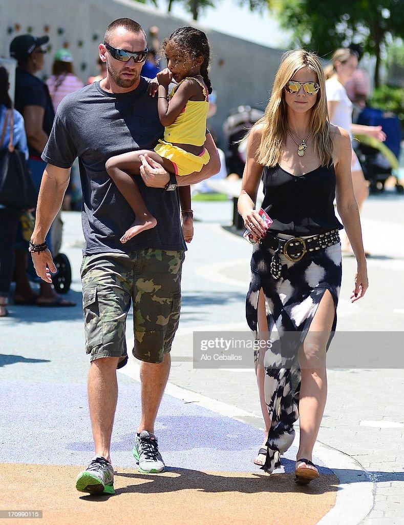 Heidi Klum, Lou Sulola Samuel and Martin Kristen are seen in Tribeca Hudson River Park on June 20, 2013 in New York City.