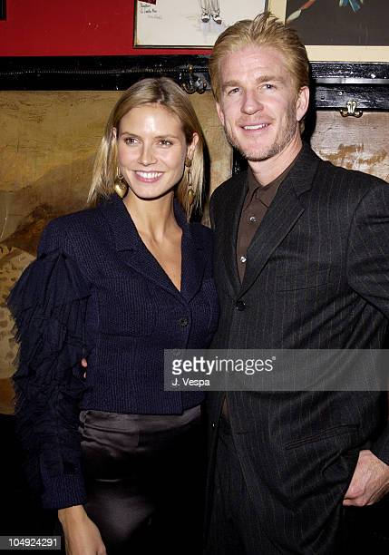 Heidi Klum Matthew Modine during Race to Deliver Celebrity Auction to benefit God's Love We Deliver at Elaine's Restaurant in New York City New York...