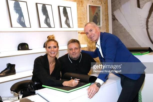 Heidi Klum photographer John Rankin Waddell aka Rankin and stylist JeanClaude Jitrois attend 'Heidi Klum by Rankin' Heidi Klum Rankin launch book at...