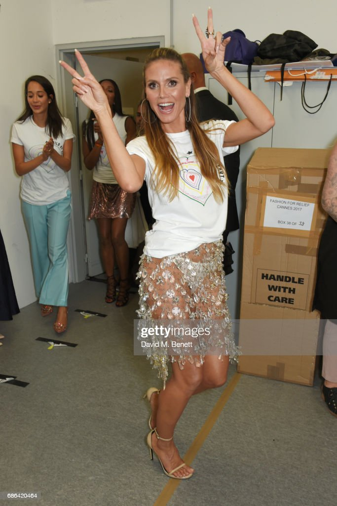 Heidi Klum poses backstage at the Fashion for Relief event during the 70th annual Cannes Film Festival at Aeroport Cannes Mandelieu on May 21, 2017 in Cannes, France.