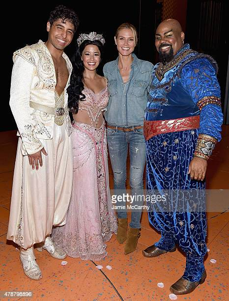 Heidi Klum poses backstage with Disney's 'Aladdin The Musical' On Broadway cast members Trent Saunders Courtney Reed and James Monroe Iglehart at New...