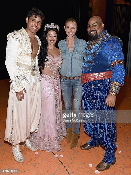 Heidi Klum poses backstage with Disney's Aladdin The Musical On Broadway cast members Trent Saunders Courtney Reed and James Monroe Iglehart at New...
