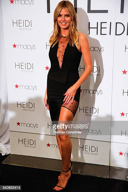 Heidi Klum poses for photos inside Macy's during the Heidi Klum Lingerie Party at Macy's Herald Square on June 23 2016 in New York City